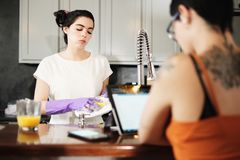 Homosexual People Lesbian Woman Upset for Chores And Dish Washing stock photos