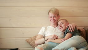 Homosexuality, same-sex marriage concept - happy male gay couple hugging at home stock video