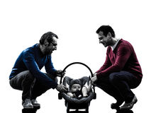 Homosexuals  parents men family with baby silhouette Royalty Free Stock Photography