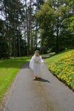 Hon önskar att vara en ängel royaltyfria foton