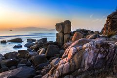 Nature Seascape with Exotic Boulders at Sunrise at Hon Chong Promontory stock image