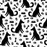 Hond en naadloze voetafdrukkenpatroon Royalty-vrije Stock Foto's