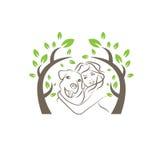 hond en vrouwen onder de boom Stock Afbeelding
