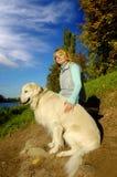 Hond met eigenaar Stock Foto
