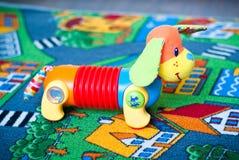 Hond op de mat Stock Foto's