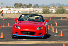 Honda 2000. Red japanese sports car competing in autocross race stock photo