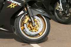 Honda CBRXX front tyre with silver and gold colors Stock Photography
