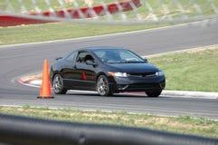 Honda Civic Si, der auf Rennen-Kurs antreibt Lizenzfreies Stockfoto