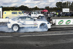 Drag racing. Napierville september 13, 2014 side view of honda crx on the track making a smoke show on the track during drag event Stock Photos