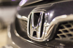 Honda logo on a car. ABU DHABI, UAE - NOV 26, 2016: Honda company logo on a car illuminated at night stock photos