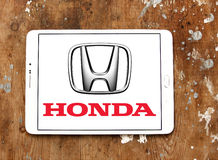 Honda logo. Logo of honda car brand on samsung tablet on wooden background royalty free stock photo
