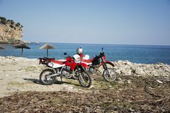 Honda motorbikes on the beach Stock Images