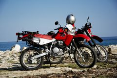 Honda motorbikes on the beach Royalty Free Stock Image