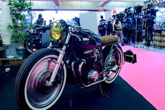 Honda motorcycle modified cafe racer style in an exhibition of time. royalty free stock photography