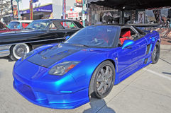 Honda NSX. This electric blue Honda NSX is set up for racing with rear air scoops to cool the high performance brakes, quick fill fuel tank, lowered suspension royalty free stock photo
