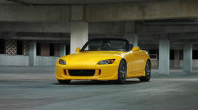 Honda S2000 In Parking Garage. A photograph of a Honda S2000 convertible sports car in a parking deck. See my portfolio for more automotive images stock photo