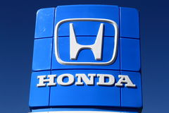 Honda Sign. Honda brand sign on blue sky background royalty free stock photos