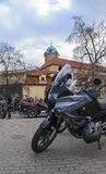 Honda XL125V Varadero motorbike, Podebrady castle on back stock photo