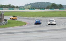 Hondas and subaru  lapping sepang Stock Photography