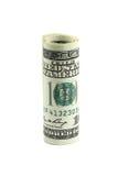 Honderd die dollarrekening in een broodje wordt gerold Stock Foto's