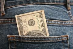 Honderd dollars in een zak Stock Foto's
