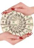 Honderd dollars in handen Stock Foto's