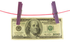 Honderd dollars voor twee wasknijpers op een koord Royalty-vrije Stock Afbeeldingen