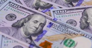 Honderd dollarsbankbiljetten stock video