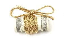 Honderd dollarsrekening met koord Stock Afbeelding