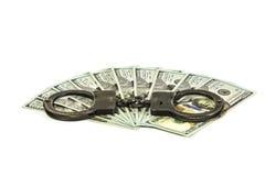 Honderd dollarsrekeningen en Amerikaanse metaalhandcuffs Stock Fotografie