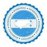 Honduras översikt och flagga i den rubber stämpeln för tappning av Royaltyfria Bilder
