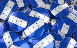 Honduras Badges Background - Pile of Honduran Flag Buttons. Royalty Free Stock Photography