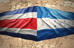 Honduras and Costa Rica. Waving Honduran and Costa Rica flags on the of the political map of the world Stock Photos