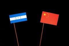 Honduras flag with Chinese flag on black. Background stock photos