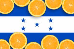 Honduras flag in citrus fruit slices horizontal frame. Honduras flag in horizontal frame of orange citrus fruit slices. Concept of growing as well as import and vector illustration