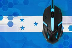 Honduras flag  and computer mouse. Concept of country representing e-sports team. Honduras flag  and modern backlit computer mouse. Concept of country stock images