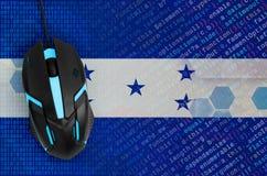Honduras flag and computer mouse. Digital threat, illegal actions on the Internet. Honduras flag and modern backlit computer mouse. The concept of digital threat royalty free stock photos
