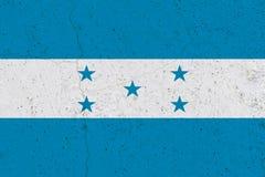 Honduras flag on concrete wall. Patriotic grunge background. National flag of Honduras stock image
