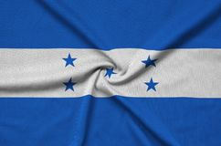 Honduras flag is depicted on a sports cloth fabric with many folds. Sport team banner. Honduras flag is depicted on a sports cloth fabric with many folds. Sport royalty free stock photos