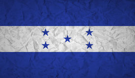 Honduras flag with the effect of crumpled paper and grunge Stock Image