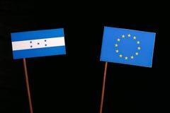 Honduras flag with European Union EU flag  on black. Background Royalty Free Stock Images