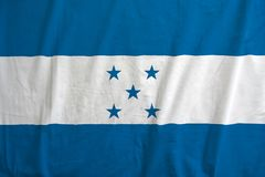 Honduras flag on the fabric texture. Honduras flag on the fabric texture background,Vintage style stock photos