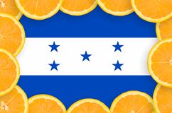 Honduras flag in fresh citrus fruit slices frame. Honduras flag in frame of orange citrus fruit slices. Concept of growing as well as import and export of citrus royalty free illustration