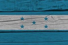 Honduras flag painted on old wood plank. Patriotic background. National flag of Honduras vector illustration