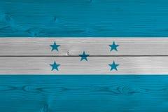 Honduras flag painted on old wood plank. Patriotic background. National flag of Honduras stock illustration
