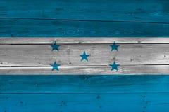 Honduras flag painted on old wood plank. Patriotic background. National flag of Honduras stock image