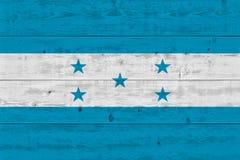Honduras flag painted on old wood plank. Patriotic background. National flag of Honduras stock images