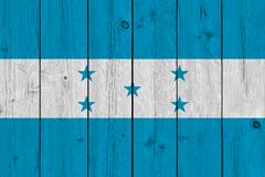 Honduras flag painted on old wood plank. Patriotic background. National flag of Honduras royalty free stock photos