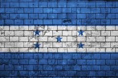 Honduras flag is painted onto an old brick wall vector illustration