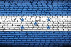 Honduras flag is painted onto an old brick wall stock illustration